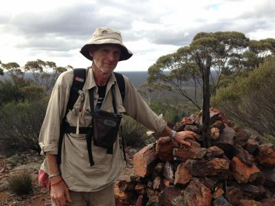 Greg arrives at the top of Bungalbin Hill, the end of his destination, 15 July 2014.